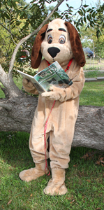 Individual in dog costume reading
