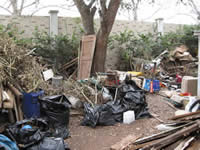 Piles of trash and junk outside