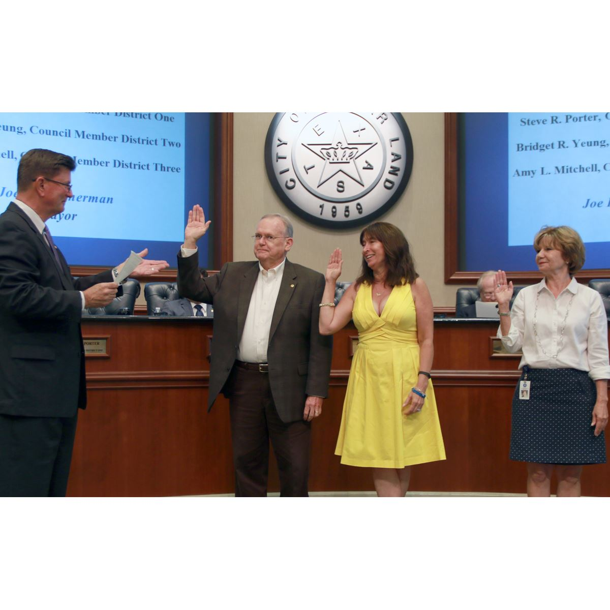 Mayor Joe Zimmerman delivers the oaths of office to (Pictured L-R) Porter, Mitchell and Yeung.