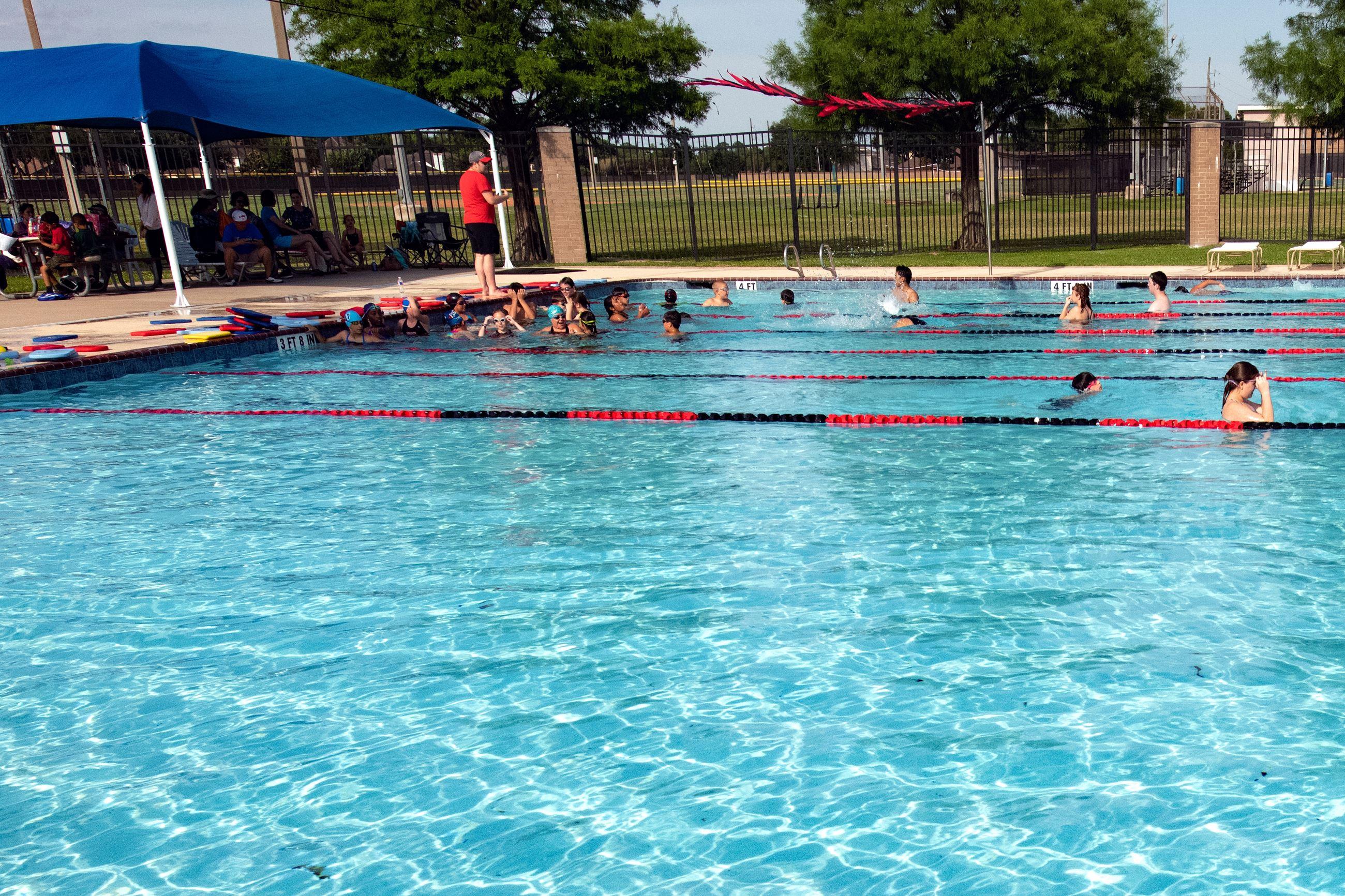 People In Pool Mun Swim Race